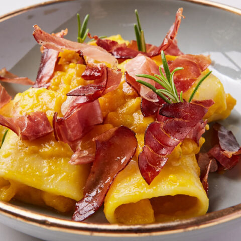 Pasta with pumpkin, speck and rosemary