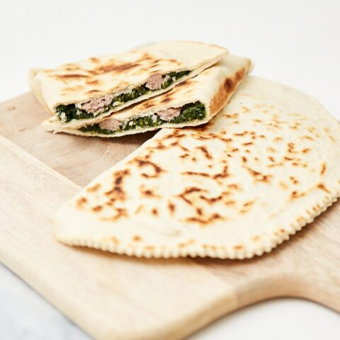 Piadina with savoy cabbage and sausage